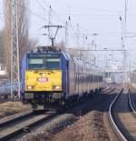 Rostock-Spezial/122272/146-519-4-mit-interconnex68904-von-warnemuende 146 519-4 mit InterConnex68904 von Warnemünde Richtung Leipzig Hbf bei der Durchfahrt am S-Bahnhof Rostock-Holbeinplatz.(22.02.2011)