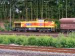 MaK 1206/112862/eine-mak-1206-der-eisenbahn-und Eine MaK 1206 der Eisenbahn und Häfen ist am 23.07.2010 mit einem Güterzug in Dortmund-Marten-Süd unterwegs.